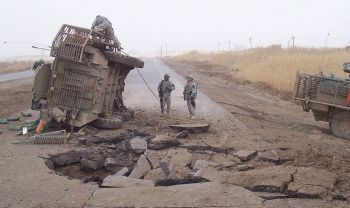 1024px-Buried_IED_blast_in_2007_in_Iraq
