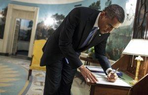 044857436-president-barack-obama-signs-a