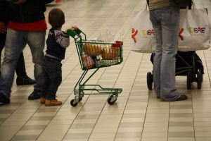 1024px-7074_-_A_baby_contributes_to_his_mom's_shopping_-_Foto_Giovanni_Dall'Orto,_Verbania,_Jan_5_2011